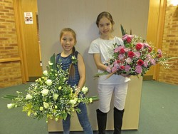 School girls showing their arrangements